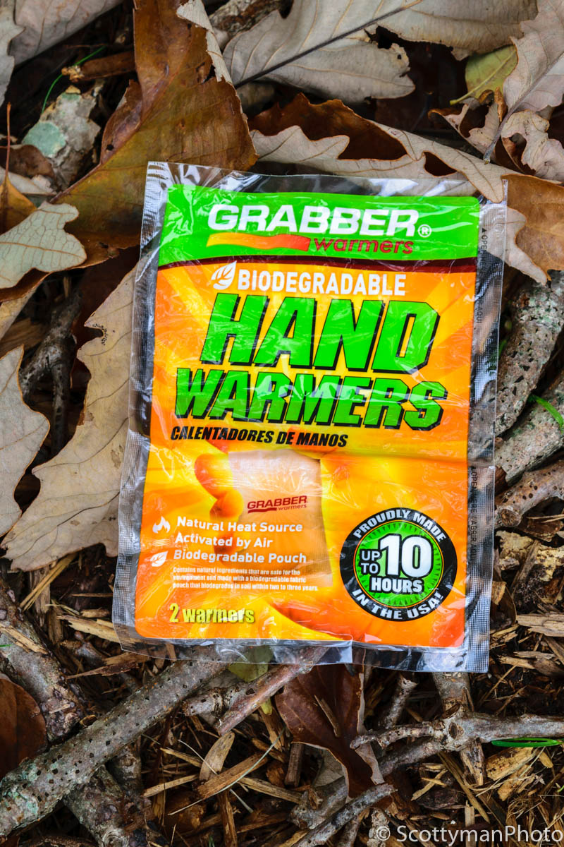 Winter photography tips using a pair of Grabber biodegradable hand warmers lying on the ground