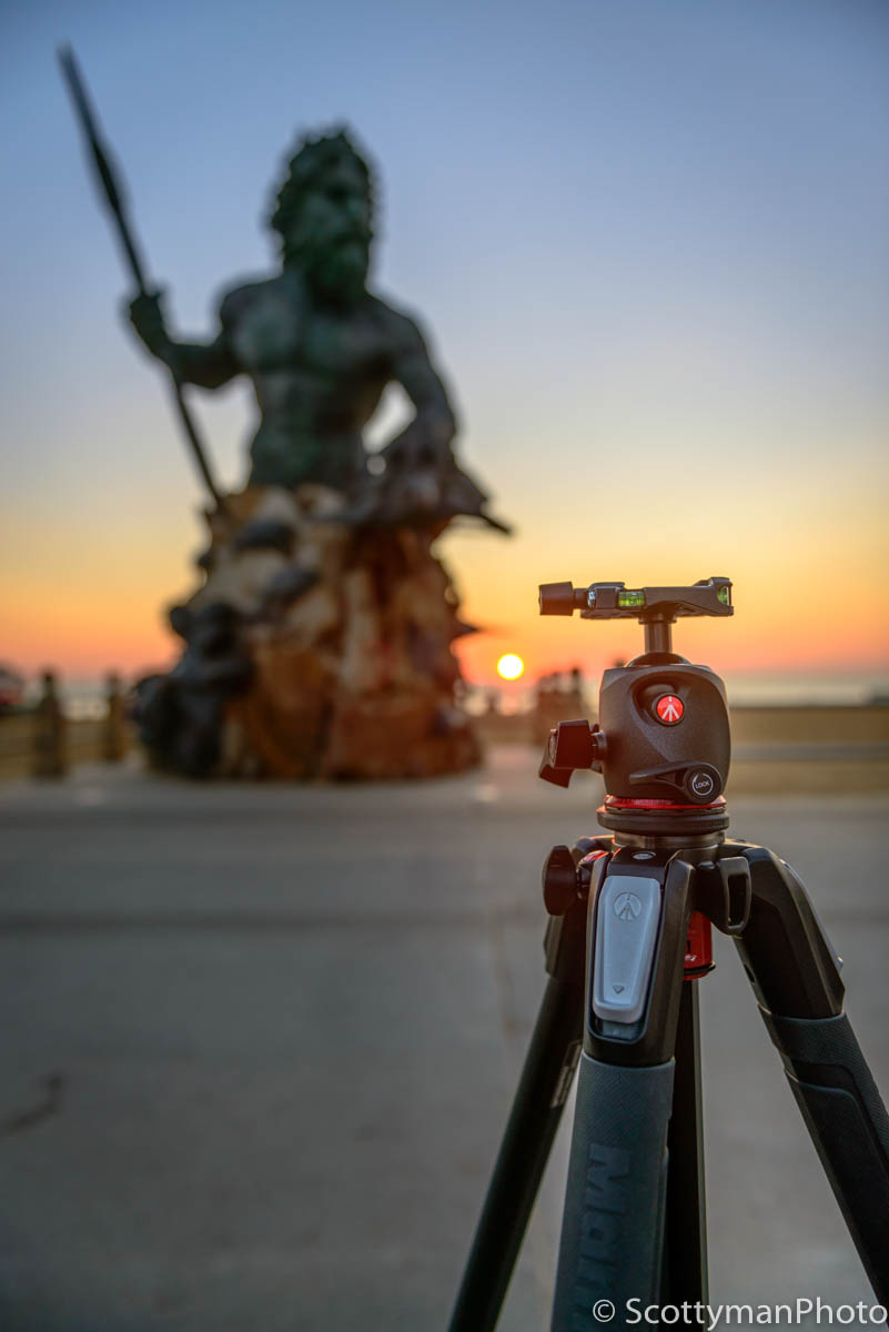 An image of the Manfrotto XPRO Ball Head on a tripod positioned in front of the King Neptune monument in Virginia Beach