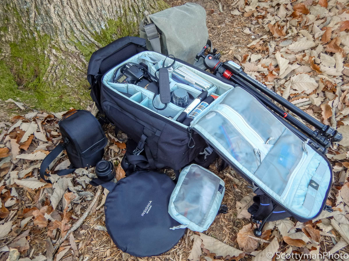 Does photography gear matter? An image of a Lowepro Trekker 450 backpack with camera gear accessories.